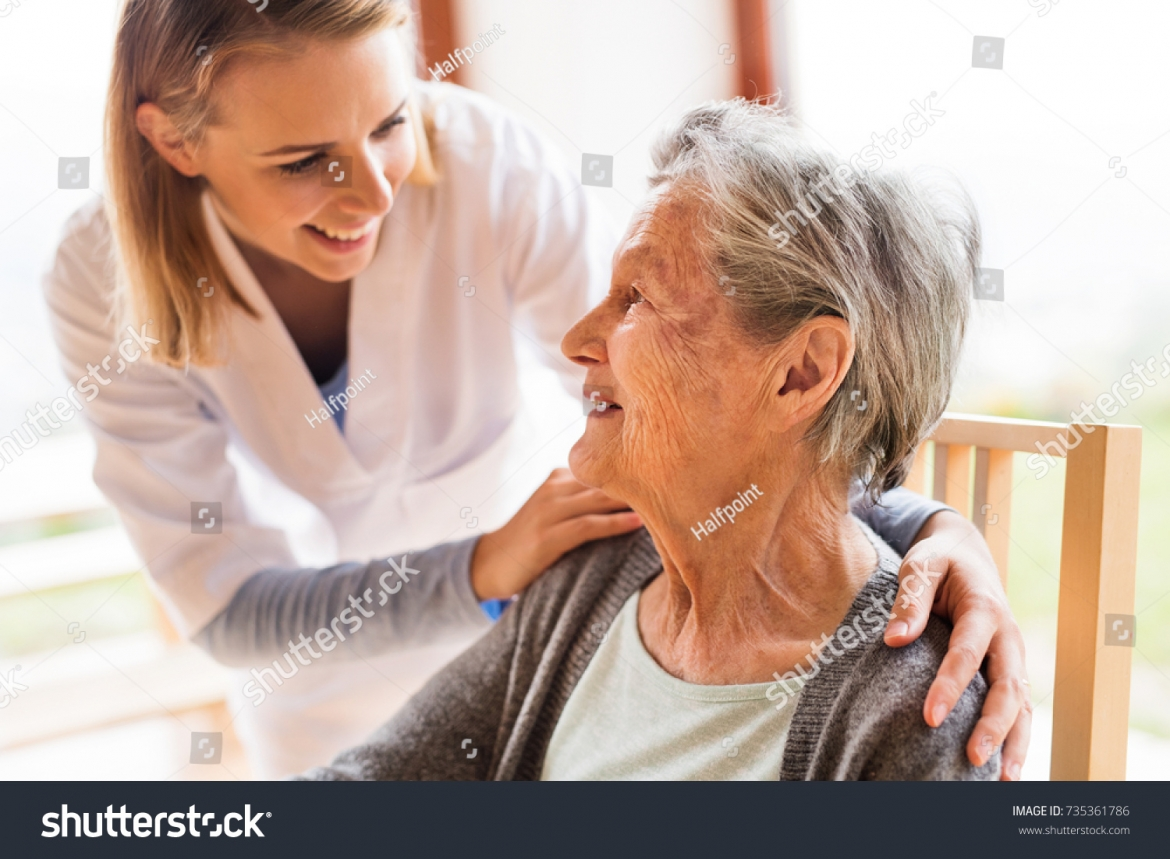 stock-photo-health-visitor-and-a-senior-woman-during-home-visit-735361786.jpg